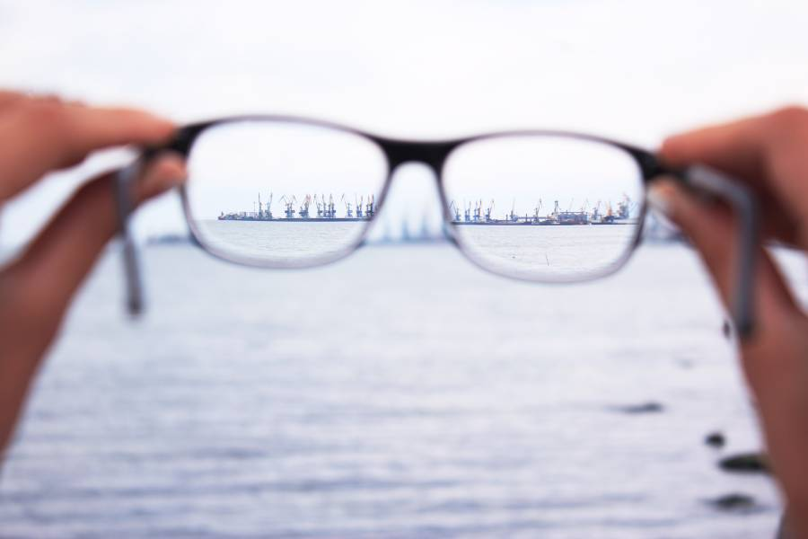 Looking an oilrig in the sea through the reading glasses